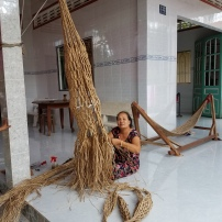 This lady is making a custom hammock from bamboo or banana leaves. It will take her almost 10 days to finish.