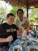 "Our host giving ""handsome"" John a gift of dragon eye fruit (or longan)."