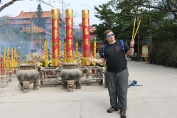 Posing in front of the HUGE sticks burning for Buddha.