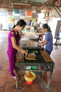 These women are spreading the coconut toffee paste into molds. Once it hardens, they cut it into small squares.
