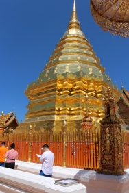 Copper-plated chedi - the most sacred part of the temple. We had to take our shoes off and I put a scarf around my shoulders to show respect.
