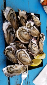 "Oysters ""natural"" style, with lemon."