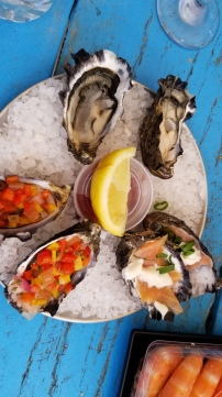 Oysters three ways: natural, with bellpepper and with salmon and brie.