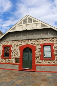 """Original buildings made of the regional """"red"""" stone from the nearby quarry."""
