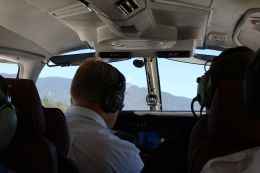 John sitting up front with our pilot, Vincent.